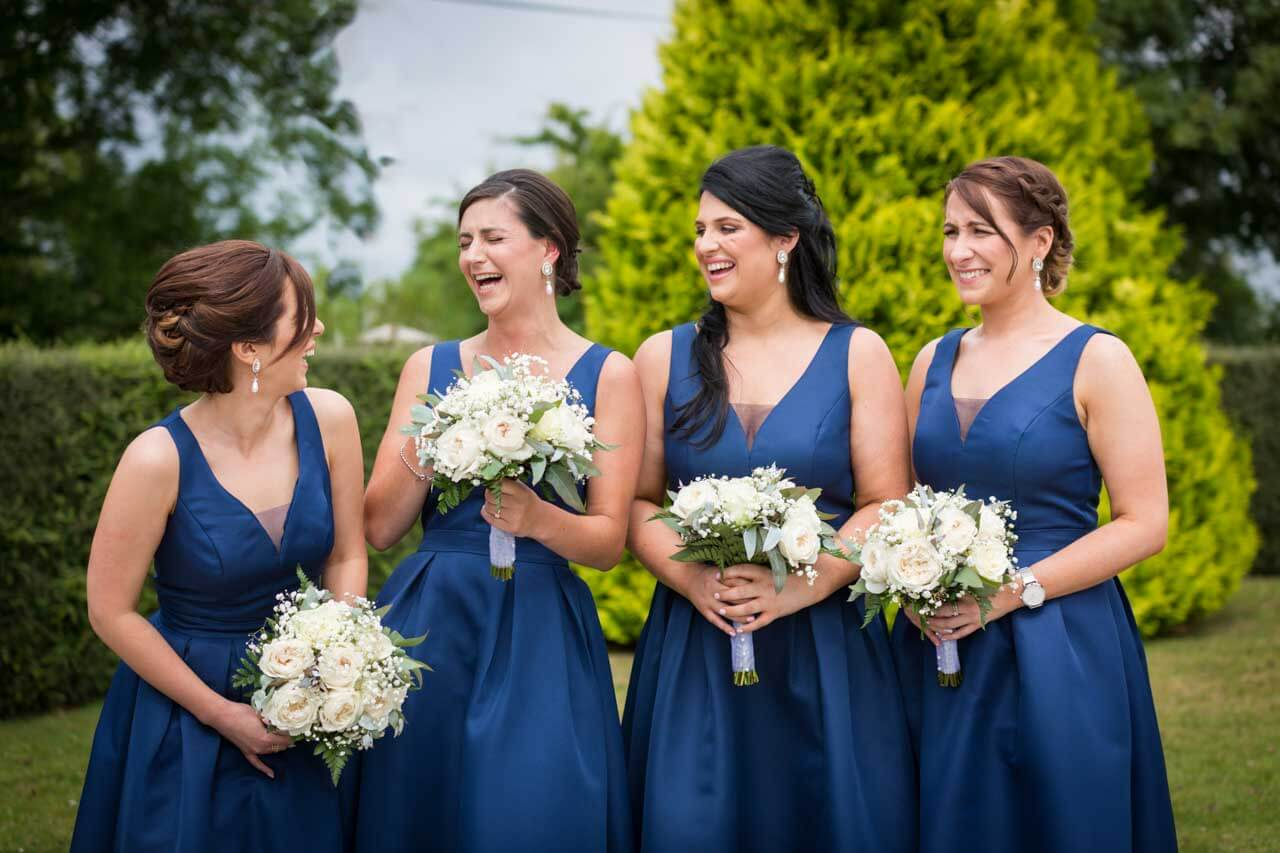 Bridesmaids all having a laugh on the wedding day