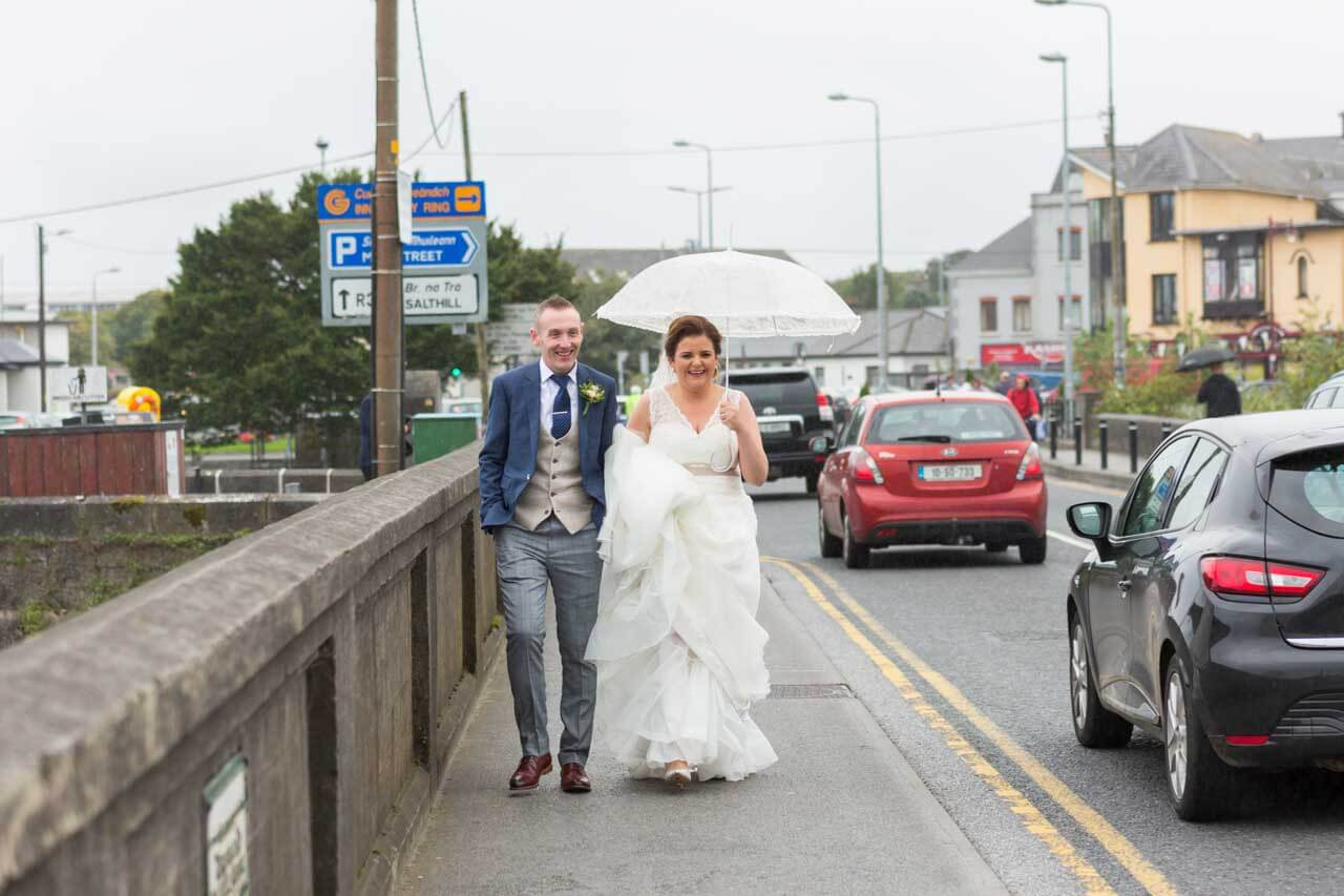 The happy couple walking the Galway streets during their wedding
