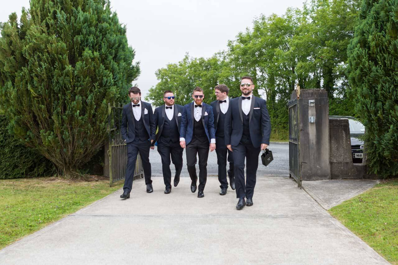 Groomsmen arriving at the church