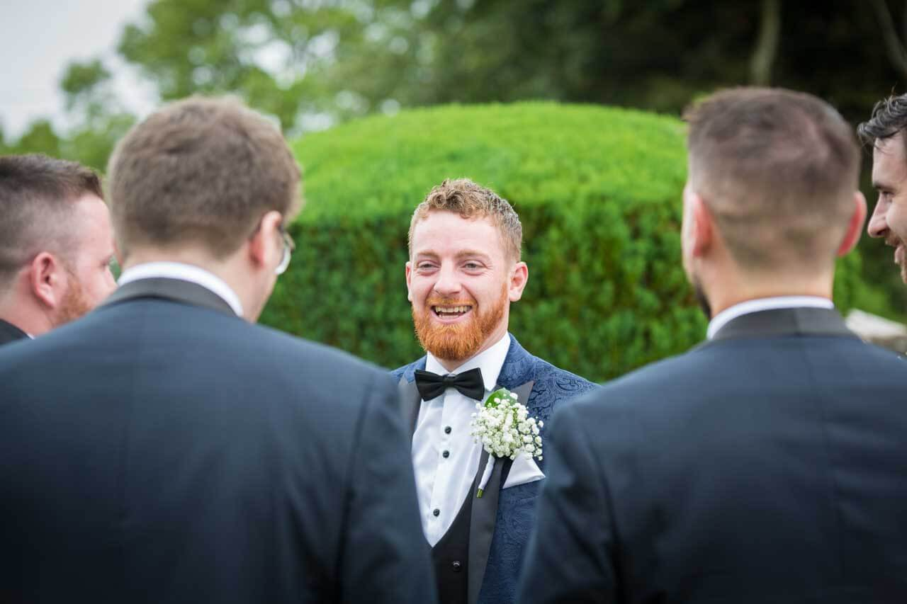 A happy wedding photograph of the groom